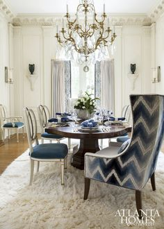 DINING TABLE Martin Nash CHAIRS Modern History with custom finish DRAPERY Kravet ALL OTHER FURNISHINGS AND ACCESSORIES Boxwoods Gardens & Gifts