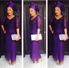 Love, love, love this purple lace. Nigerian wedding guest in Purple lace Iro and Buba and Gele with Silver bag and shoes. Swanky & Dashing Aso-Ebi Styles | Wedding Digest Naija