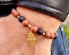 Check out this item in my Etsy shop https://www.etsy.com/listing/230195622/hamsa-bracelet-mens-hamsa-bracelet-matte