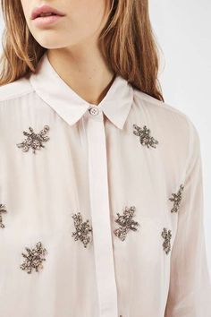 Refresh your shirt collection with this pretty pale pink embellished version with all-over sequin and beaded bug detail. Wear tucked in or out of jeans for a day-to-night look. #Topshop