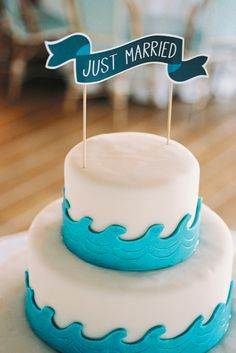 "alternative to a traditional cake topper. use a cute ""just married"" sign! :)"