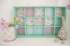 Use pretty paper/wallpaper to cover tins or to line little shelves