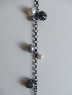 CO2 charm bracelet.  Oxidised silver chain studed with unique CO2 orbs and grey & white freshwater pearls.    Elizamar jewellery by Jody Cornett