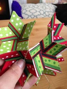 Heres a beauty of an ornament from Jennifer Strauser that is fun to make. It can be crisp fanciful or flowery depending upon the fabrics you choose. What a beautiful handmade gift! Origami Christmas Star, Christmas Crafts To Make, 3d Christmas, Christmas Sewing, Christmas Fabric, How To Make Ornaments, Handmade Christmas, Folded Fabric Ornaments, Quilted Christmas Ornaments