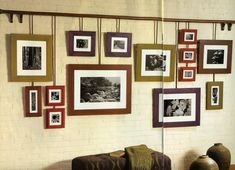 Add even more distinctive flair by hanging the frames with wires or velvet ribbons from a large wooden dowel or use hemp rope for a rustic look. For this grouping, smaller dowels were drilled and and screwed to the main rod.