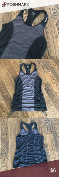 Reebok workout tank Great condition, rouched side details make it versatile for different activities. Great for yoga. Reebok Tops Tank Tops