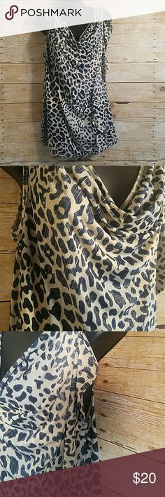 """Lane Bryant Cheetah Cowl Neck Wrap Tank Adorable tank top! Colors are navy blue, beige, and a light metallic blue. Top has a little bit of shimmer. Neckline is a draped cowl neck with a drape wrapping on the left side of the shirt.  Measurements (laying flat unstretched) Length 27"""" Armpit to armpit 19 1/2"""" 95% Polyester, 5% spandex  Size 14/16 Lane Bryant Tops"""