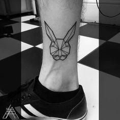 Fun little geometric rabbit head by @tattoolabar  For bookings and enquiries contact the studio: ☎02072786960  theshop@skunxtattoo.com #skunx #skunxtattoo #blacktattoo  #animaltattoo #geometric #rabbit #geometrictattoo #London #uktattooist