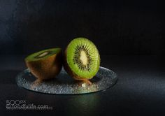Pic: Kiwi fruit on round mirror with droplets