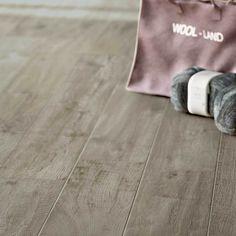 Creekwood™ - Glazed Porcelain Ash River in 6 x 36 on the floor.