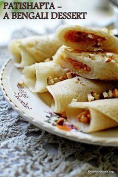 Patishapta - pancakes with coconut and khoya filling (Bengali Sweet Recipes) Indian Desserts, Indian Sweets, Indian Dishes, Indian Food Recipes, Vegetarian Recipes, Cooking Recipes, Bangladeshi Food, Bengali Food, Indian Pancakes