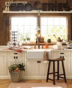 Charming Country Kitchen   Content in a Cottage Nice, a lot of recycled wood and like the white wash, note how they made the shelf over the windows...looks good.