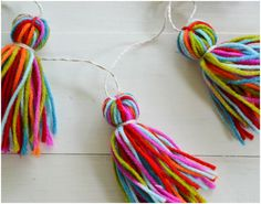 Cute Yarn Tassel Garland from jacksandsam.com - links to directions  - Create - Celebrate - Reuse - Could use scraps of yarn.
