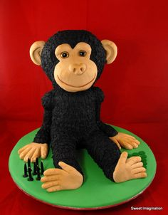 3D Monkey cake. Body, arms, legs are all cake and fondant/ Head is carved styrofoam covered in fondant.