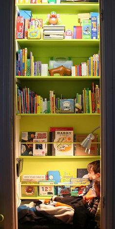 Cute reading nook. I used to love to read in my closet as a kid. It wasn't this well thought out & organized, but I loved it. nicholnaranjo
