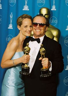 """1998: Helen Hunt and Jack Nicholson hold up their Oscars for Best Actress and Best Actor for """"As Good As It Gets."""""""