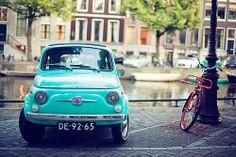 dutch little car near an Amsterdam canal (fiat)