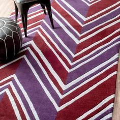 This purple and red chevron rug is a modern statement piece. So bold!   NuLoom Cine Hand Tufted Payne Rug Chevron Area Rugs, Purple Area Rugs, Faux Cowhide Rug, Trellis Rug, Red Chevron, Rugs Usa, Cow Hide Rug, Color Of The Year