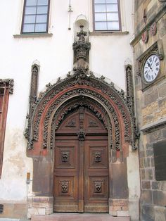 Gothic Door to the Old Town Hall, Prague.  Late Gothic door to the Town Hall and Tower, carved by Matthias Rejsek.