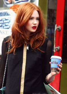 Notice the cup in her hand that says cafe nerd...we must find this place and go there