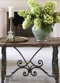 Beautiful trestle table, candlestick and green hydrangea - elements of a serene room.