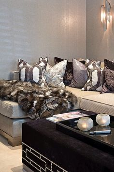 Luxurious corner sofa with quilted fabric upholstery, stunning contrast piped cushions and fur throw by Hill House Interiors