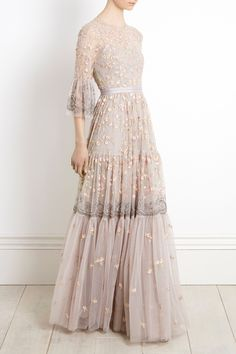 NEW for Christmas 2017, the Climbing Blossom Gown combines delicate pastel floral embroidery with sparkling embellishment. This dramatic floor length gown in dove grey has a flattering mid sleeve length and the tiered detailing on the decorated skirt gives a gentle fullness to the silhouette. Our signature grosgrain ribbon detail at the waist completes the look.
