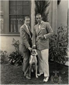 Rudolph Valentino, his dog and widely known boy novelist Horace Wade who came to visit him at his bungalow at United Artists studios during the production of The Eagle (1925)