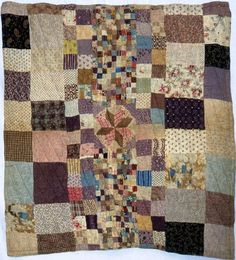 Double-sided Cot Quilt from the Dennis Cann Family, in the York Quilt Museum. Date: 1890-1900.   This double-sided cot quilt is made from different coloured printed cottons, and has an eight pointed central star with squares and rectangles on one side, and diamond mosaic patchwork design on the reverse.