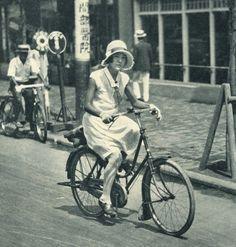 Modern girl riding a bicycle at Tokyo - Japan - 1931