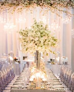 With a good reception venue do simple large flower center pieces with baby's breath and white roses