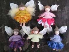 Fairies with acorn hats and flower petal skirts. Flower petal wings and felt clothing.