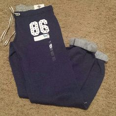 Vs pink soft Capri Pants! New with tags !! New with tags! Perfect for keeping yourself warm and stylish. Dark blue on color. PINK Victoria's Secret Pants Capris