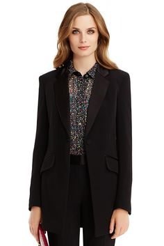 Long and lean, this striking, beautifully constructed smoking jacket is a seductive mix of masculine and feminine. Pair with the DVF Genesis long pant for the full look. Front single button closure.