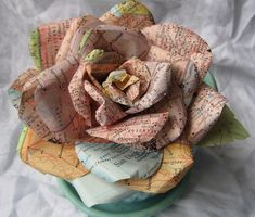 Handmade Paper Rose Vintage Map paper Sherbet shades San Diego Talladega fo Doesn't tell how, but you can find directions for a paper rose easily.