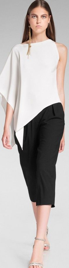 Donna Karan. I like the top. Not the pants.