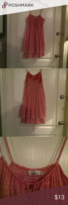 Pretty summer dress Red and while, light, summer dress. It is above the knee and ties at the bodice. cala Dresses Mini