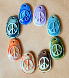 8 Handmade Ceramic Peace Signs in a Rainbow of Colors.  These are from Beadfreaky; I found them on Etsy.