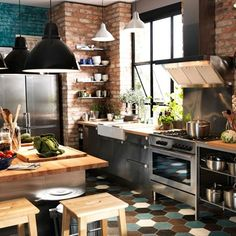 Explore our kitchen design ideas, including this exposed brick kitchen with a geometric tiled floor