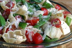 A cold pasta salad made with your favorite pasta, halved grape tomatoes, mozzarella, fresh basil and sugar snap peas tossed with a light and tangy dressing.