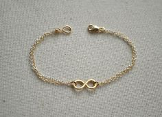 silver and gold infinity bracelet