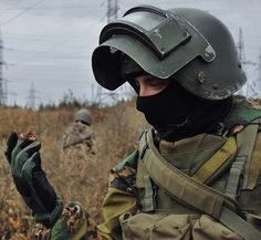 Unknown Russian Spetsnaz. They're trained to shrug off the pain of being shot, and are sent in as heavy shock troops. The armour and helmet pictured here can withstand .50cal bullets, reportedly. Currently the spearhead group, Alfa company, is being sent into Crimea. The last time Alfa Company was sent into a warzone in numbers was when about 30 of them stormed the capital of a middle eastern country and assassinated the leadership.