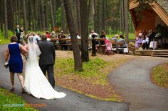 No wedding aisle could be better as the bride is walked up the Woodlands Trail by her parents. #CypressHills #Weddings #Saskatchewan