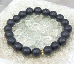Matte Black Onyx Bracelet 8 mm Faceted Round by jivanmuktijewelry