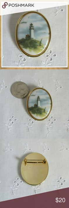 "Vintage Ceramic Lighthouse Pin Brooch EUC Love the sea? This is the perfect pin to show off you love of the ocean. Beautiful vintage brooch with a lighthouse scene printed onto a ceramic cabochon. Gold tone metal setting. Excellent condition. Measures 1 3/4"" long by 1 1/4"" wide. Vintage Jewelry Brooches"