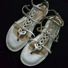 Metallic Coach Sandals I loved this style so much that I bought two pairs. These were worn about five times. They have adjustable straps on two sides. Very cute and easy to match any outfit. Used-Very Good Condition Coach Shoes Sandals