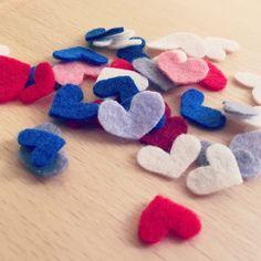 Tiny tiny felt hearts
