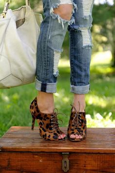 Womens suede leopard lace-up booties with rolled up denim jeans