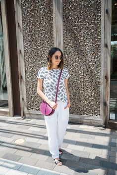 @roressclothes closet ideas #women fashion outfit #clothing style apparel White T-shirt with Black Feathers via