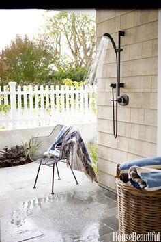 In a Southern California bachelor pad designed by Parrish Chilcoat and Joe Lucas, an outdoor shower is mounted above a patio facing the beach.Click through for more outdoor showers.